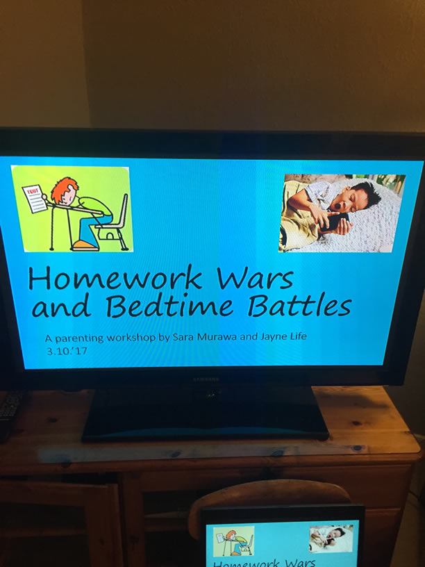 Homework Wars slidfeshow presentation by Sara Murawa and Jayne Life showing on TV screen